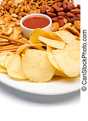 Salty snacks served on a plate