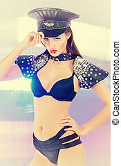 salute - Portrait of a stunning sexual police girl posing at...