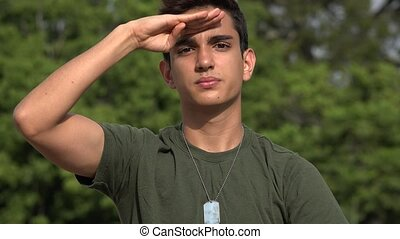 Saluting Male Hispanic Teenage Soldier Recruit