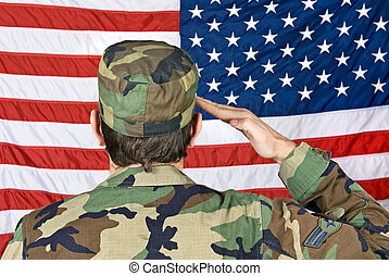Saluting the American Flag - A vetern soldier salutes his...
