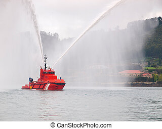Salvage tugboat with two big water jets in the Ferrol estuary.