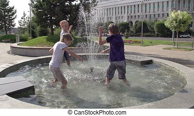 Salvation from the Heat - Children stand knee-deep in the...