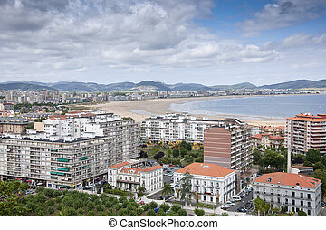 Picture of Salve Beach and beachfront apartment building in Laredo (Spain)