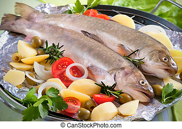 Salvelinus - fish with the vegetables on a grill
