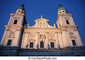 Cathedral of Saint Rupert in Salzburg, Austria. Baroque religious architecture. Characteristic light of artificial illumination and early evening sky.