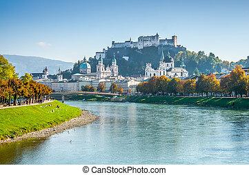 Beautiful view of Salzburg skyline with Festung Hohensalzburg and Salzach river in summer with dramatic cloudscape, Salzburg, Salzburger Land, Austria