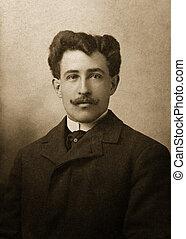 sam - antique photograph of man in suit coat with moustache