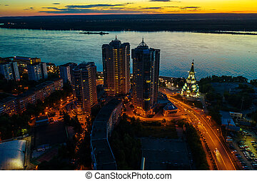 Night city Samara, aerial panorama with many living and commercial building