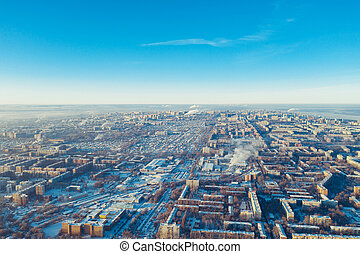 Winter russian city Samara, aerial panorama with many living and commercial building covered by snow