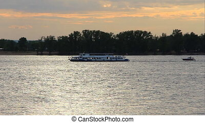 Two small ships sail along the Volga - SAMARA, RUSSIA - MAY...