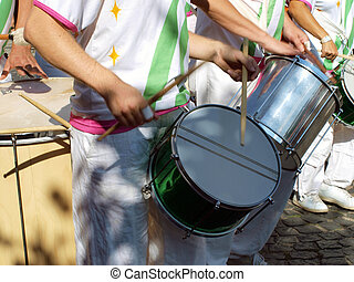 Samba carnival parade musicians play drums