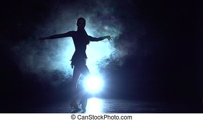 Samba dance in the studio, silhouette. Slow motion