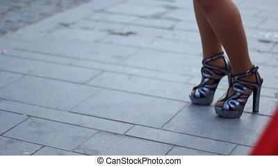 Close-up shot of a samba girl steps dancing with high heels.