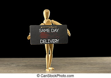 Quick delivery services business card images and stock photos 13 same day delivery sign close up shot of a wooden mannequin reheart Choice Image