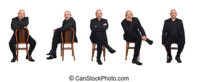 same man sitting with a chair on white background, side view
