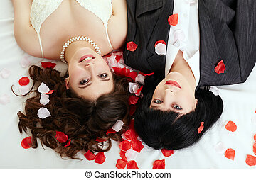 Same-sex marriage. Top view of happy couple posing at camera