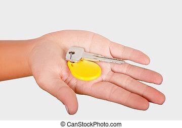 samica, łańcuch, żółty, dłoń, wisior, klucz, okrągły