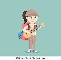 samica, wycieczkowicz, grając gitarę
