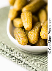 Samll dill pickles in bowl shallow dof close up