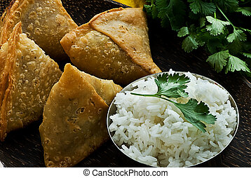 Samosa - Indian samosa's on a wooden plate with rice. ...