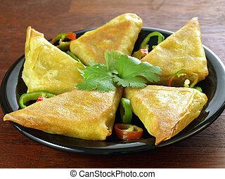 Samosas - Indian appetizer: vegetarian samosas with...