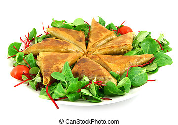samosas on a plate - samosas and salad on a plate, isolated ...