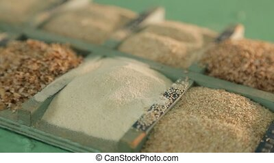 Samples of ground grain at a flour mill. - Flour of...