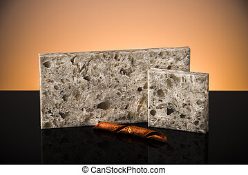 Samples of kitchen granite counter tops on black surface