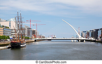 Samuel Beckett Bridge over River Liffey at day in Dublin,...