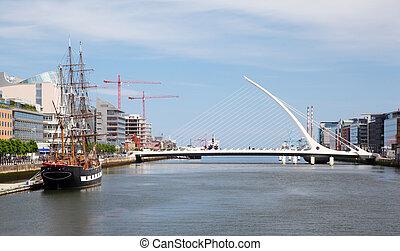 Samuel Beckett Bridge over River Liffey at day in Dublin,...