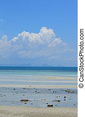 Samui island seascape with puffy white clouds over blue sky and sea,Thailand