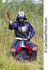 Samurai in armor showing direction by folded fan