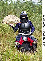 Samurai in armor with fan