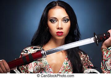 Samurai woman - Young woman with samurai sword fashion.