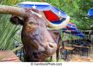 A stuffed steer greets patrons at this colorful riverwalk cafe