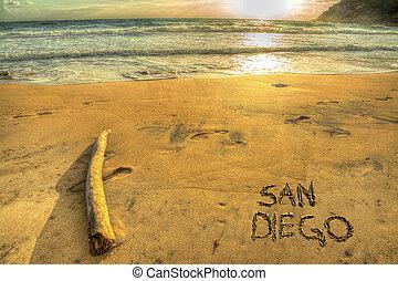 """san diego"" written on a golden shore at sunset"
