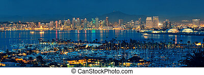 San Diego downtown skyline at night with boat in harbor.