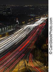 Fast night traffic on the San Diego 405 Freeway in west Los Angeles, California.
