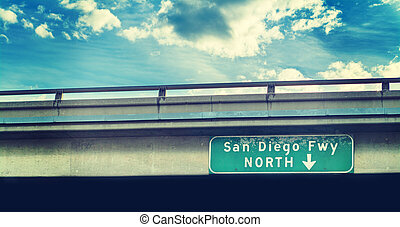 San Diego freeway sign under a cloudy sky