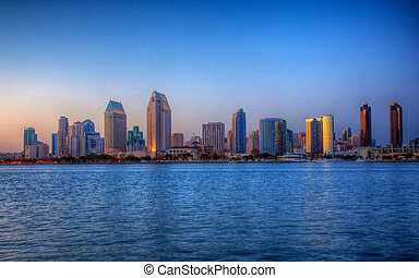 San Diego skyline on clear evening in HDR - Sun setting ...