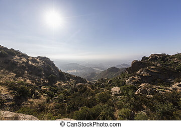Morning sun above the San Fernando Valley in Los Angeles, California. View from Rocky Peak Park in the Santa Susana Mountains.