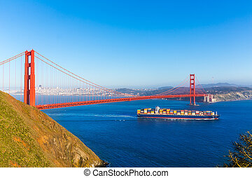 San Francisco Golden Gate Bridge merchant ship in California...