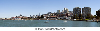 San Francisco Maritime Museum from the bay with the skyline ...