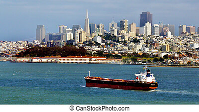 Cargo ship with San Francisco skyline - SAN FRANCISCO - MAY...
