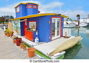 SAN FRANCISCO - MAY 21 2015:Colorful houseboat in Sausalito California. Sausalito houseboat community consists of more than 400 houseboats of various shapes, sizes and values at the north end of town.
