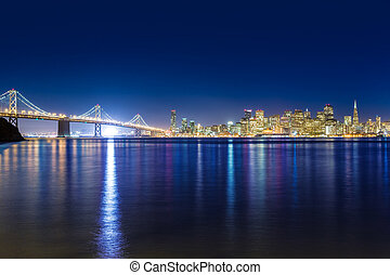 San Francisco sunset skyline California bay water reflection...