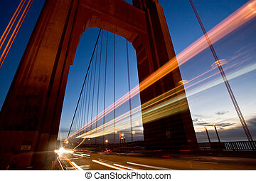 Long exposure of cars passing through one of the towers of the Golden Gate Bridge. Shot in San Francisco.