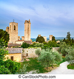 San Gimignano landmark medieval town on sunset, towers and park. Tuscany, Italy