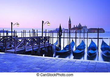 San Giorgio Maggiore church and gondolas at dawn in Venice.