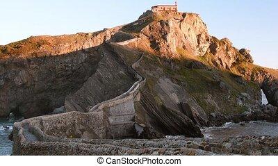 San Juan de Gaztelugatxe and its stairs at sunrise, Basque...
